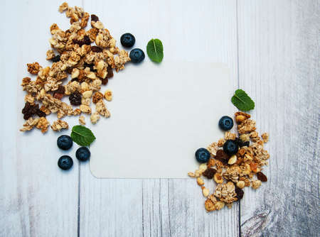 Granola and blank recipe paper on a table Stock Photo
