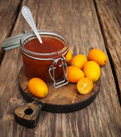 clementines: Delicious kumquat  jam on a old wooden table Stock Photo