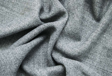 Grey draped woolen scarf - fabric background