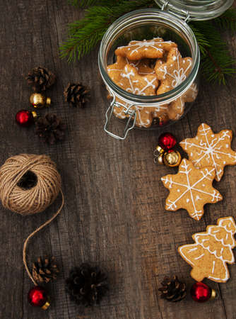 Jar with Christmas gingerbread cookies on a old wooden table Stock Photo - 90571667