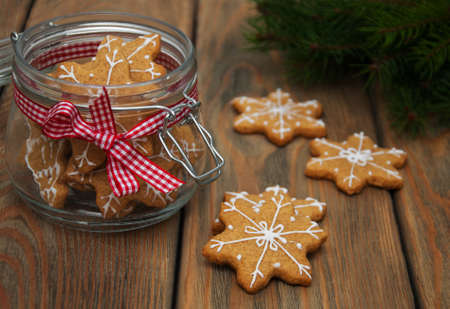 Jar with Christmas gingerbread cookies on a old wooden table