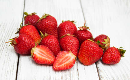 Ripe strawberries on a old wooden table