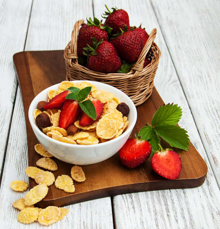 Muesli with strawberries on a old wooden table Stock Photo