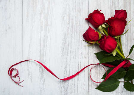 Bouquet of red  roses on a old wooden background
