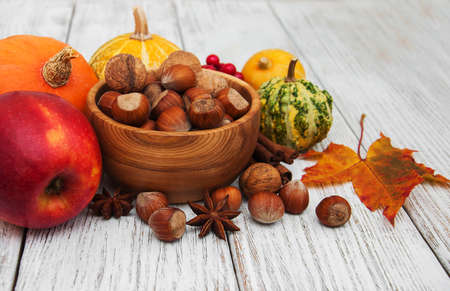 Hazelnuts and pumpkins on a old wooden table