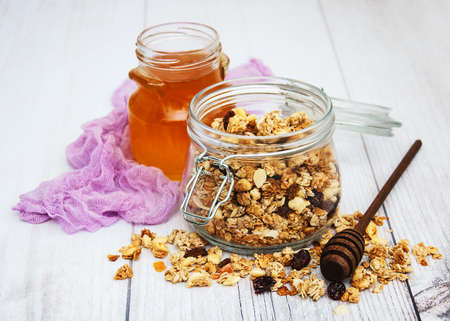 Homemade granola in jar on a old wooden table Stockfoto