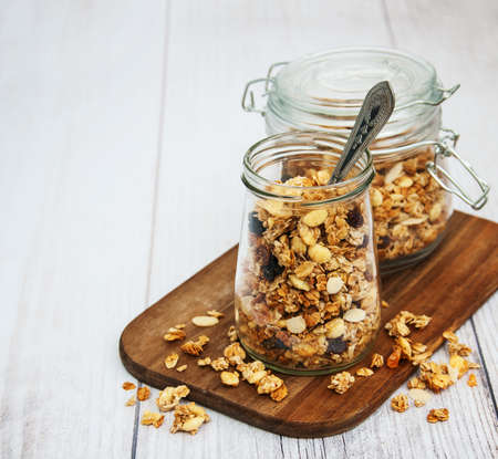 Homemade  granola in jar on a old wooden  table 스톡 콘텐츠