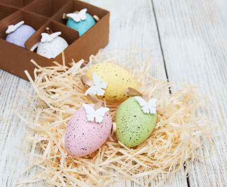 Easter eggs and spring  blossom on a old wooden background Stock Photo