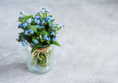 bouquet of forget me nots in glass  vase