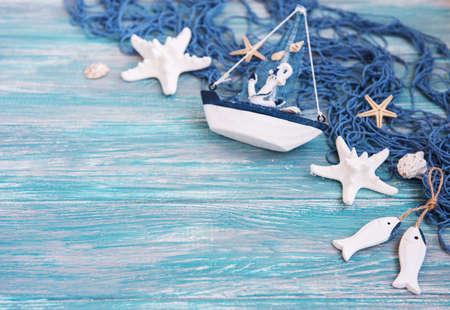 Fishing net with starfish and sea decorations  on a  wooden background