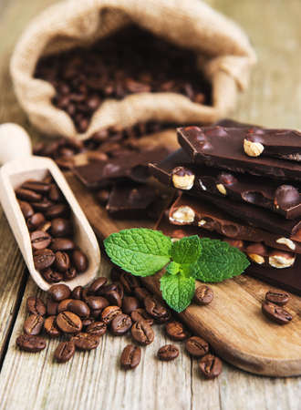 Chocolate and coffee beans on a old wooden table