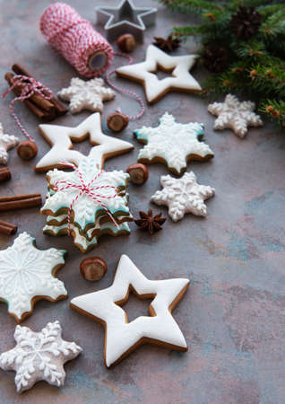 Christmas homemade gingerbread cookies on a concrete background