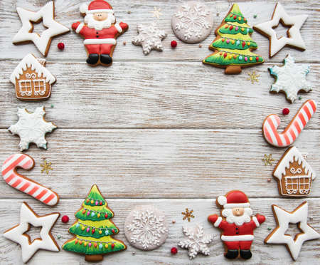 Christmas homemade gingerbread cookies  on a old wooden background