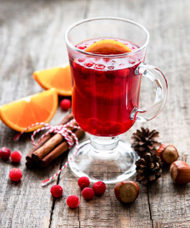 Glass of hot mulled wine with oranges and spices Standard-Bild