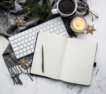 Notebook, keyboard, cup of coffee and Christmas decorations - flat lay