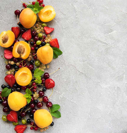 Fresh summer fruits on a concrete table