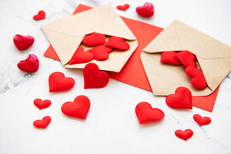 Valentines day romantic background - envelopes with decorative hearts on a marble background Фото со стока
