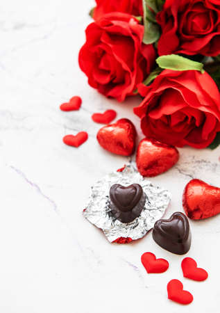 Valentines day romantic background -  chocolate candy and roses on a marble  background Stock Photo