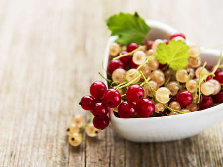 red currants in bowl in the heart shape