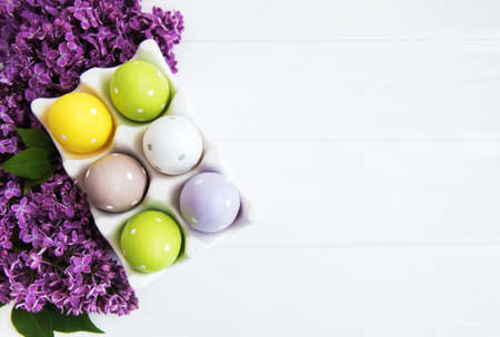 Easter eggs in tray with lilac flowers