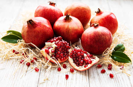 Juicy and ripe pomegranates  on an old wooden table