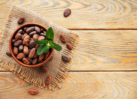 Natural  cocoa beans  on a old wooden Stock fotó