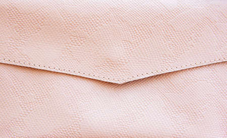 Pink leather texture may be used as background