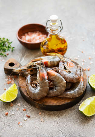 Fresh raw  prawns and spices on  grey concrete background Stock Photo