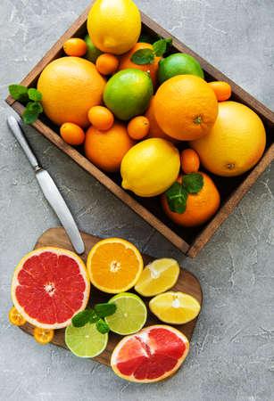 box with citrus fresh fruits on a concrete background Stock fotó
