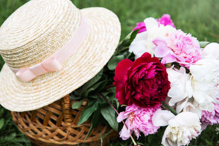 Beautiful bouquet of bright peony  flowers in basket 写真素材