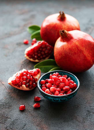 Ripe pomegranate fruits on  black concrete Stock Photo