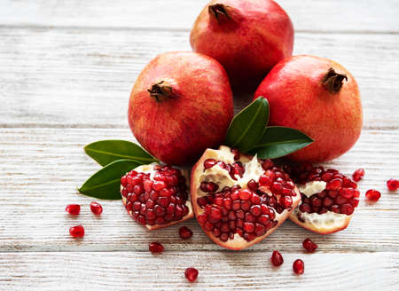 Ripe pomegranate fruits on  wooden vintage