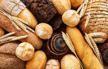 Assortimento di pane cotto come sfondo alimentare Archivio Fotografico