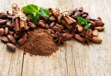 Natural  cocoa powder and cocoa beans  on a old wooden  background Banco de Imagens