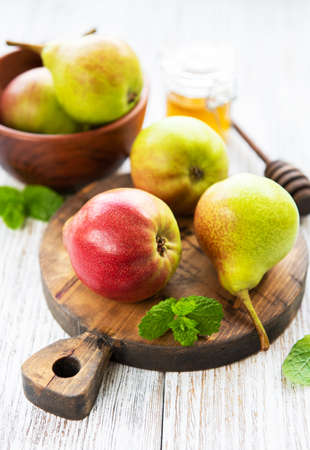 Pears on a wooden board on a old table