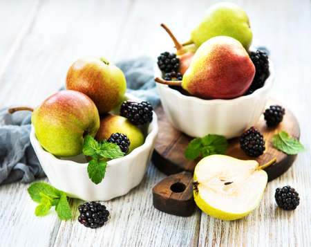 Pears in a bowl on a old wooden table