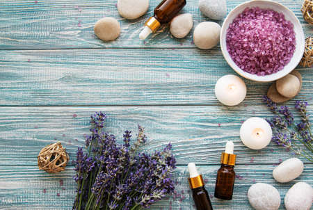 Flat lay composition with lavender flowers and natural cosmetics on old wooden background