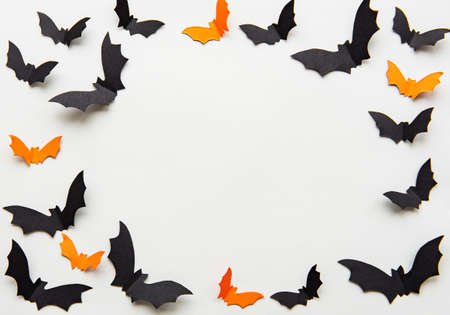 holidays  concept - halloween paper black and orange decorations  with blank copy space over grey background Stock Photo