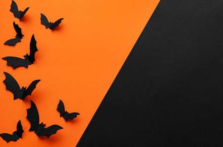 holidays  concept - halloween paper decorations  with blank copy space over orange and black background Imagens