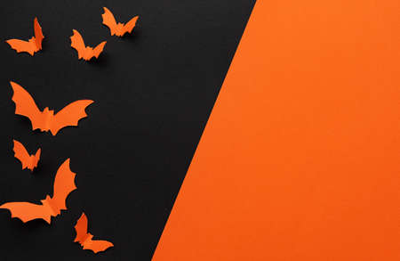 holidays  concept - halloween paper decorations  with blank copy space over orange and black background Stock fotó