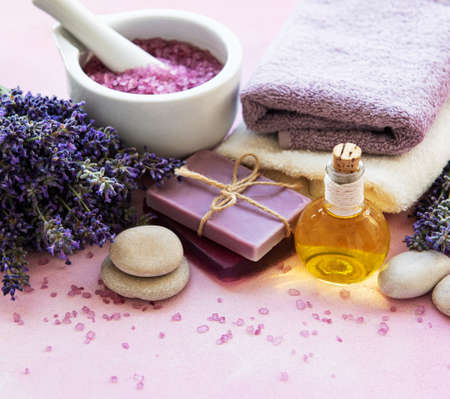 Lavender flowers and natural cosmetic on pink concrete  background