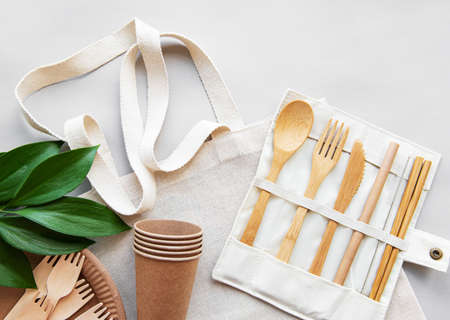 Cotton bag and recycled tableware top view. Zero waste, eco friendly, plastic free background. Flat lay. Stok Fotoğraf