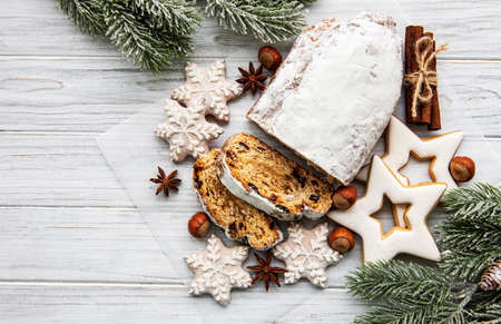 Christmas stollen on wooden background. Traditional Christmas festive pastry dessert. Stollen for Christmas.