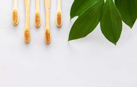 Bamboo toothbrushes on white background. Zero waste and use biodegradable and recyclable material concept. Flat lay. Imagens