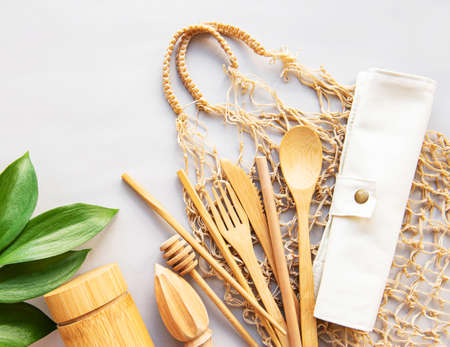 Set of Eco friendly bamboo cutlery and eco bag. Sustainable lifestyle. Plastic free concept. Imagens