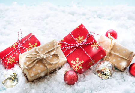 Christmas gift boxes and decorations on a snow background