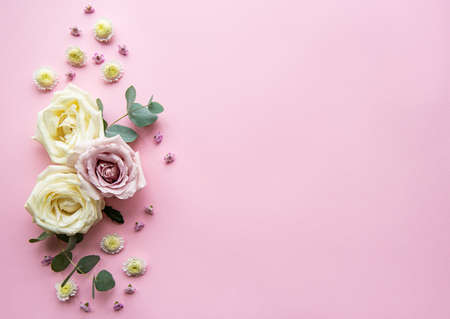 Flowers composition. Frame made of various colorful flowers on light pink background. Flat lay, top view, copy space