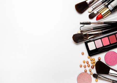 Set of decorative cosmetics on a white