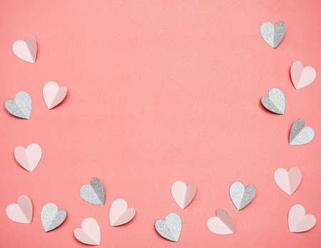 Hearts made of paper on a pink background, top view. Pink background with hearts for Valentine's day or wedding.