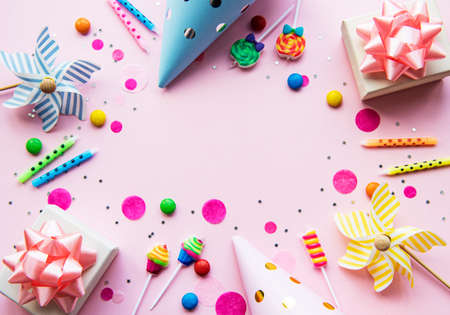 Happy birthday or party background. Flat Lay wtih birthday balloons , confetti and ribbons on pink background. Top View. Copy space. Stock Photo
